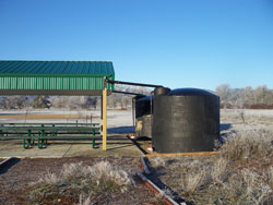 Two 2500 Gallon Water Tanks Connected To a Picnic Area